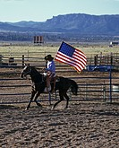 Horseman with american flag at the Rodeo, Ruby`s Inn, Bryce, Utah, USA