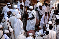 Ethiopian Orthodox Christianity Priests and debteras congregate in front of the rock hewn church Beta Maryam Lalibela Ethiopia