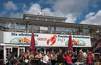 Tourists in front of sea food restaurant Gosch in List, Sylt, Schleswig Holstein, Germany