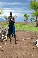 Man of the Mursi people leans against his stick Ethiopia