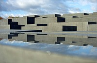 Reflection of the Stele of the Holocaust memorial in a water surface on a concrete stele, Berlin, Germany.