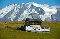 Mountain hut Restaurant Chez la Tante backed by the enormous mountain Mt. Blanc Haute_Savoie France