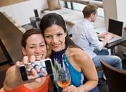 Girls taking picture at bar