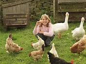 Girl Holding Egg With Hens And Geese