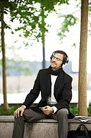 Man listening to music on coffee break
