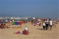 People on the main sandy beach at Tangiers, Morocco, North Africa, Africa