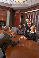 Multi_ethnic businesspeople having discussion in business meeting in boardroom