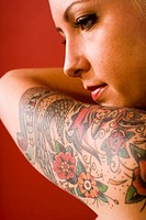 Close_up of a mid adult woman with tattoo design on arm