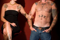 Midsection of tattooed couple