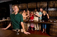 Group of people at a winery for a wine tasting