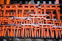 Little shinto torii doors in Fushimi Inari Taisha, Japan