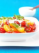Salad made out of cherry tomatoes and basil