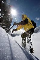 Mountaineer climbing snow covered mountain