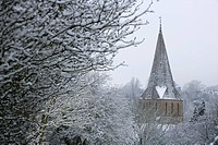 Shere church in snow, often used as a film location, Surrey, England, United Kingdom, Europe