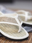 White flip_flops made of straw