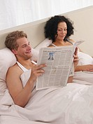 Young couple in bed (thumbnail)