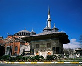 Monumental fountain and St. Sophia mosque behind, Istanbul, Turkey, Europe