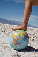 Woman´s foot on globe, Bad Waters Point, Death Valley National Park, California, United States of America, North America