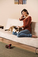 Woman on cell phone relaxing with dog