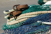 Fishing nets and ropes in a heap, extreme close-up
