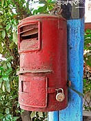 post box Mailbox, mounted on wooden pillar Chiplun, Ratnagiri, Maharashtra, India