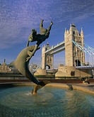 Fountain of child with dolphin and Tower Bridge, London, England, UK, Europe