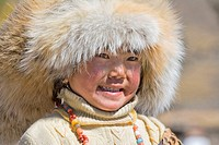 Tibetan girl is proud of her fur hat, Daocheng, Sichuan, China No model release available