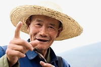 Animated Chinese man in straw hat, Dali, Yunnan, China No model release available