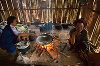 Food preparation over open fire in bamboo hut, hilltribe village, northern Thailand Blurred motion, high ISO, grain No releases available