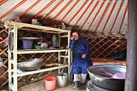 Mongolian woman in her ger tent or yurt home, north-central Mongolia No releases available