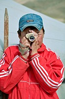 Mongolian boy takes sight with his monocular, north central Mongolia No releases available