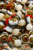 Stuffed olives with peppers, anchovies and onion. El Prat del Llobregat fair, Barcelona province, Catalonia, Spain