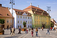 Colourfully painted houses and buildings surrounding the main old town square, Piata Mare, in the 12th century Saxon city, Sibiu, Transylvania, Romani...