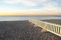 Picket fence sitting on the beach, Nice France
