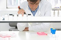 Scientist taking samples in laboratory