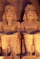 Floodlit colossi of Ramses II Ramesses the Great, seated statues on facade of temple, Abu Simbel, UNESCO World Heritage Site, Nubia, Egypt, North Afri...