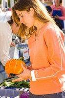 Woman shopping at fruit stand community market USA