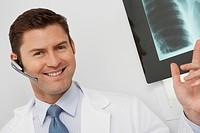Doctor holding x_ray in hospitalportrait