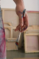 Paint on Artist's Hand and Paintbrush