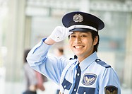 A smiling security guard