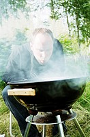 En Man Sitter Vid En Grillar Utomhus, Close_Up Of Man Barbecue Grill With Cooking