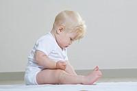 Baby girl playing on floor
