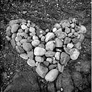 Småsten Ihopsamlade Och Formade Till Ett Hjärta På Marken, Stones In Shape Of Heart, Close_Up B&W
