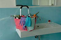 Bucket with cleaning utensils on the brim of a washbasin (thumbnail)