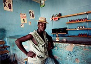 Kopia Zimbabwe FOTO: Johan Wingborg COPYRIGHT BILDHUSET, Portrait Of Mid Adult Man Sitting By Bar Counter