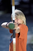 Blonde Boy targeting at the Spectator with a Toydart on a Bow _ Archery _ Weapon _ Leisure Time