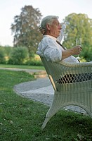Old Man in a Cane Chair with a Champagne Glass in his Hand _ Garden _ Festivity _ Twilight