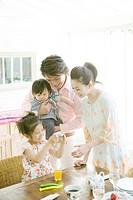 Family Looking at Digital Camera