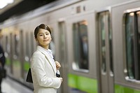 Portrait of a woman at platform, smiling