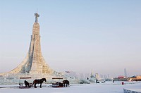 A horse and carriage and ice sculptures at the Ice Lantern Festival, Harbin, Heilongjiang Province, Northeast China, China, Asia